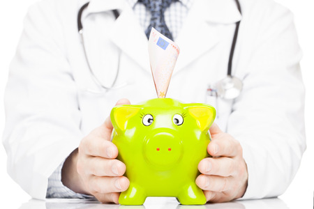 Male doctor holding piggy bank as an idea of savings for medical expenses