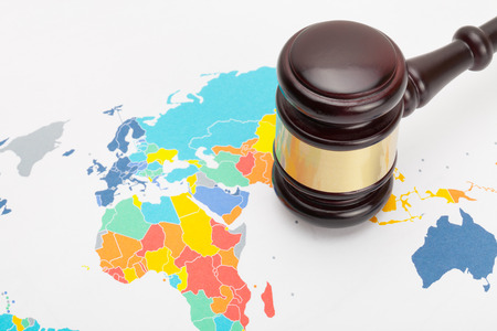 Judges gavel over world map Stock Photo