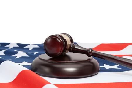 Studio shot of judge gavel and USA flag on white background
