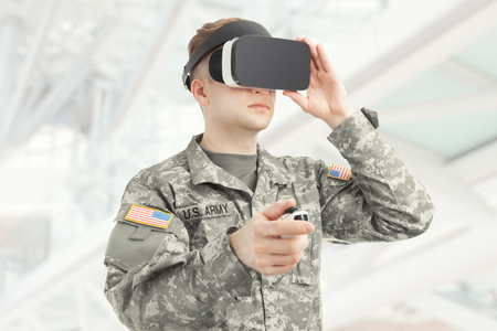 Indoors shot of American soldier wearing virtual reality glasses Stock Photo