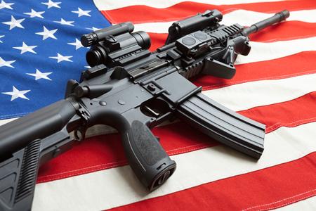Cotton flag with machine gun over it series - United States Standard-Bild