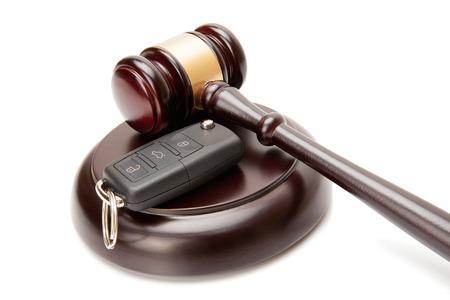 soundboard: Close up of wooden judge gavel and car keys over soundboard on white background