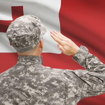National military forces with flag on background conceptual series - Tonga Stock Photo