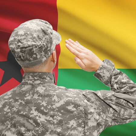 troop: National military forces with flag on background conceptual series - Guinea-Bissau