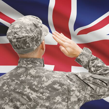 National military forces with flag on background conceptual series - United Kingdom Stock Photo