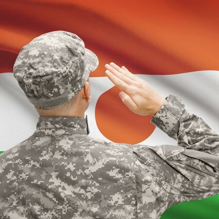 National military forces with flag on background conceptual series - Niger Stock Photo