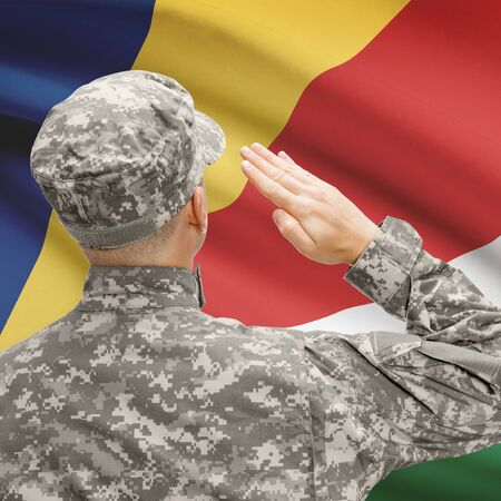 National military forces with flag on background conceptual series - Seychelles Stock Photo
