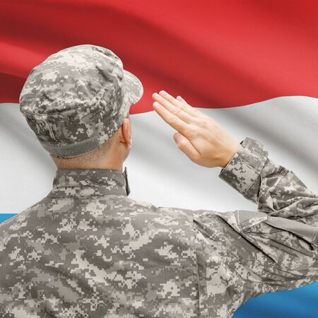 National military forces with flag on background conceptual series - Luxembourg Stock Photo