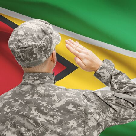troop: National military forces with flag on background conceptual series - Guyana