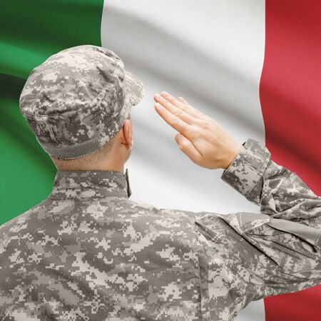 National military forces with flag on background conceptual series - Italy Stock Photo
