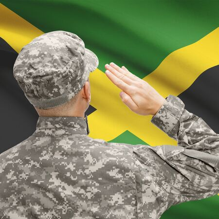jamaican man: National military forces with flag on background conceptual series - Jamaica Stock Photo