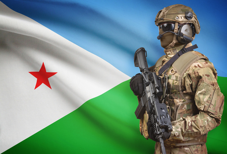 Soldier in helmet holding machine gun with national flag on background - Djibouti