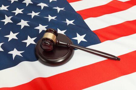 soundboard: Close up studio shot of a judge gavel and a soundboard over flag of USA