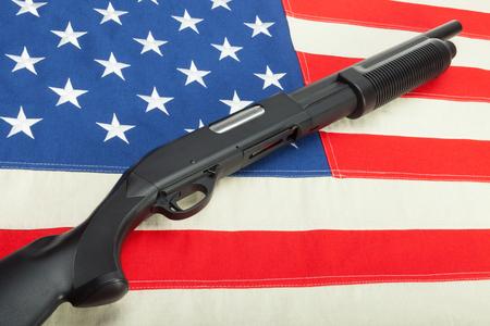 Shotgun without lables on USA flag Stock Photo