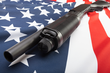 Shotgun without lables over USA flag