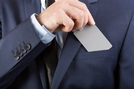 business loans: Businessman in neat suit holding blank card with YOUR TEXT OR IMAGE Stock Photo