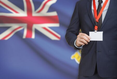 Businessman holding name card badge on a lanyard with a flag on background - Virgin Islands Stock Photo