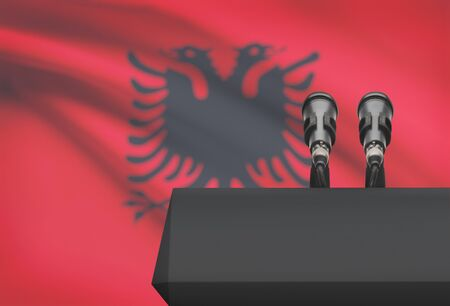 proclaim: Pulpit and two microphones with a flag on background - Albania