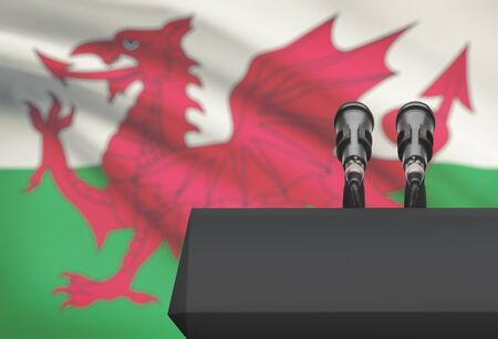 Pulpit and two microphones with a flag on background - Wales Stock Photo
