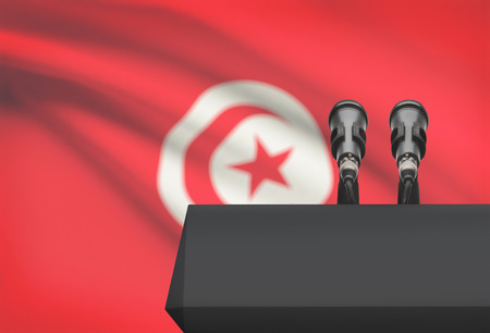 Pulpit and two microphones with a flag on background - Tunisia
