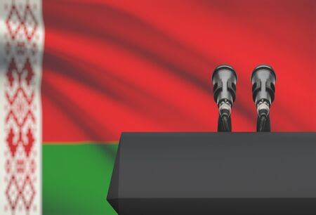 Pulpit and two microphones with a flag on background - Belarus