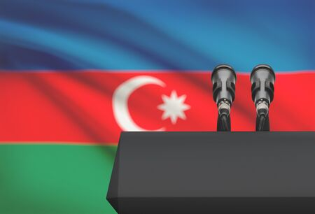 azeri: Pulpit and two microphones with a flag on background - Azerbaijan