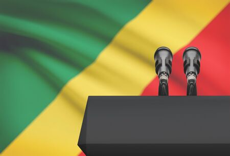 control de calidad: Pulpit and two microphones with a flag on background - Congo-Brazzaville