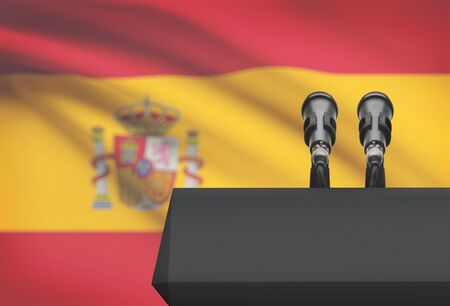 Pulpit and two microphones with a flag on background - Spain Stock Photo