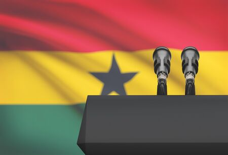 Pulpit and two microphones with a flag on background - Ghana