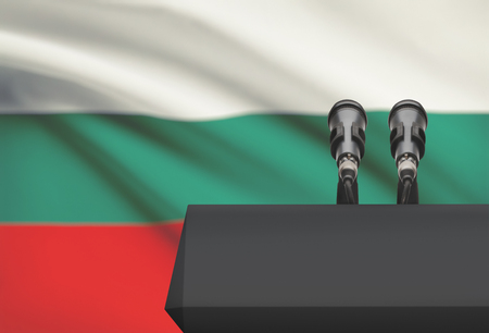 control de calidad: Pulpit and two microphones with a flag on background - Bulgaria Foto de archivo