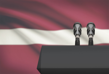 proclaim: Pulpit and two microphones with a flag on background - Latvia