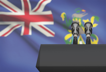 control de calidad: Pulpit and two microphones with a flag on background - Pitcairn Islands