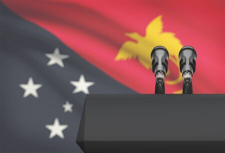 papua new guinea: Pulpit and two microphones with a flag on background - Papua New Guinea Stock Photo