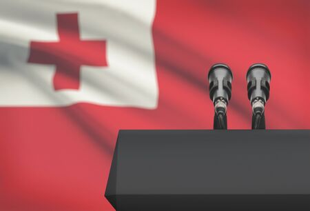 tonga: Pulpit and two microphones with a flag on background - Tonga Stock Photo