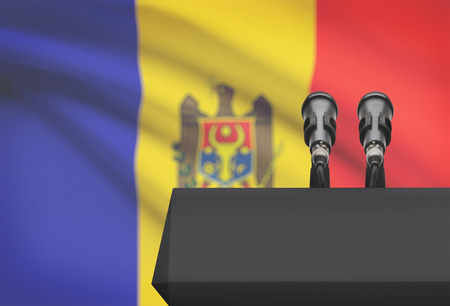 control de calidad: Pulpit and two microphones with a flag on background - Moldova