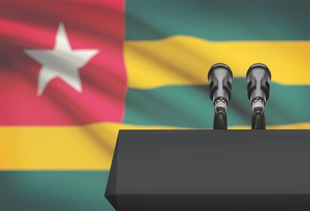 Pulpit and two microphones with a flag on background - Togo