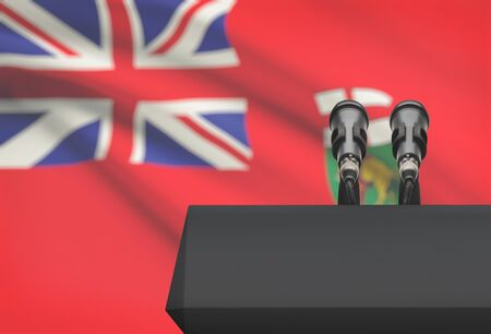 manitoba: Pulpit and two microphones with Canadian province or territory flag on background - Manitoba Stock Photo