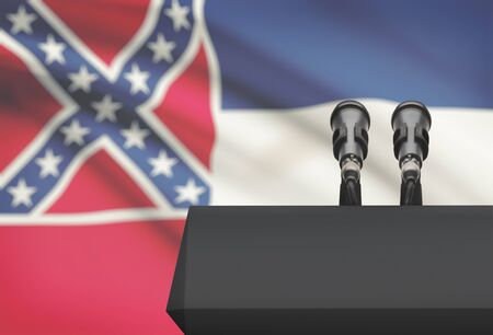 control de calidad: Pulpit and two microphones with US state flag on background - Mississippi