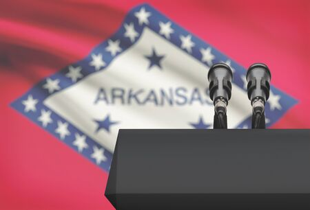 Pulpit and two microphones with US state flag on background - Arkansas Stock Photo