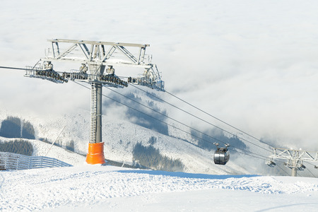 ropeway: New cable cars going up and down the mountain at a ski resort area on a sunny day Stock Photo
