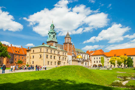 museum visit: KRAKOW, POLAND - JUNE 08, 2016: Tourists visiting famous Wawel Royal Castle and Cathedral in Krakow, Poland - June 08, 2016
