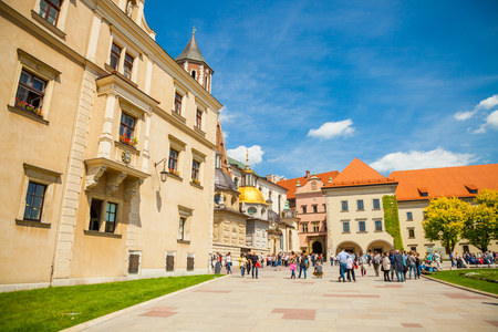 museum visit: KRAKOW, POLAND - MAY 16, 2015: Tourists heading towards famous historical complex of Wawel Royal Castle and Cathedral in Krakow, Poland - May 16, 2015