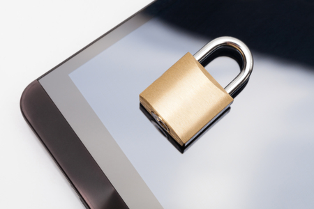 Smartphone with small locked lock over it - mobile phone security and data protection concept