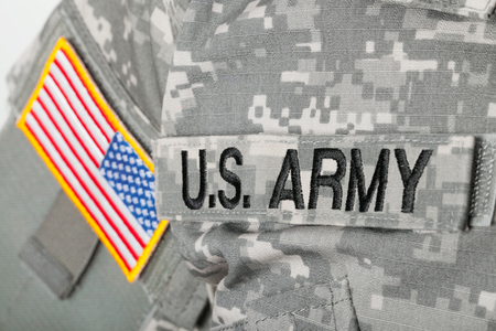 Studio shot of U.S. ARMY and USA flag patches on American solders uniform Stock Photo