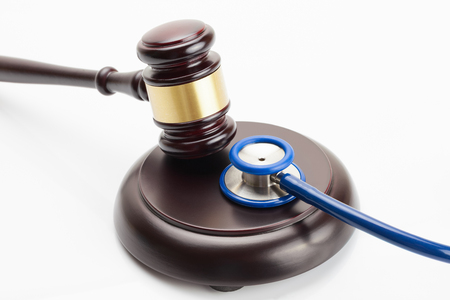 Close up studio shot of a wooden judge gavel and a stethoscope Stock Photo