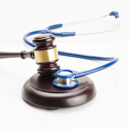 violation: Medicine and medical symbols - close up studio shot of a judge gavel and a stethoscope