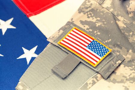 US army uniform with chevron over flag - focus on chevron. Filtered image: cross processed vintage effect.