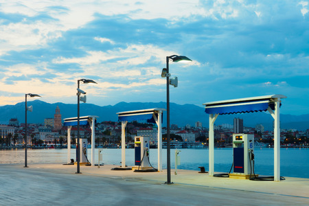 Port gas station at sunrise prepared to refill boats tanks Stock Photo