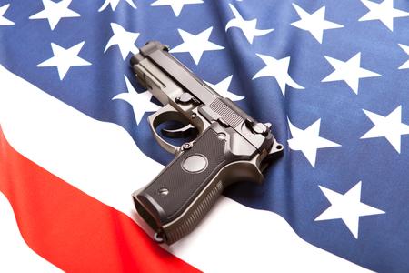 Handgun on satin USA flag - studio shoot
