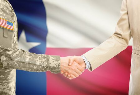American soldier in uniform and civil man in suit shaking hands with certain USA state flag on background - Texas